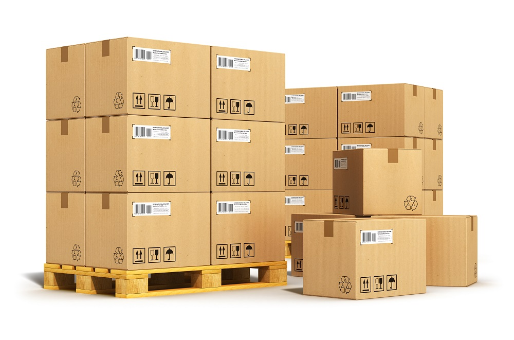 Creative cargo delivery and transportation logistics storage warehouse industry business concept: group of stacked corrugated cardboard boxes on wooden shipping pallets isolated on white background
