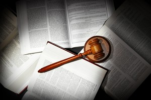 bigstock-law-books-14597240-300x199
