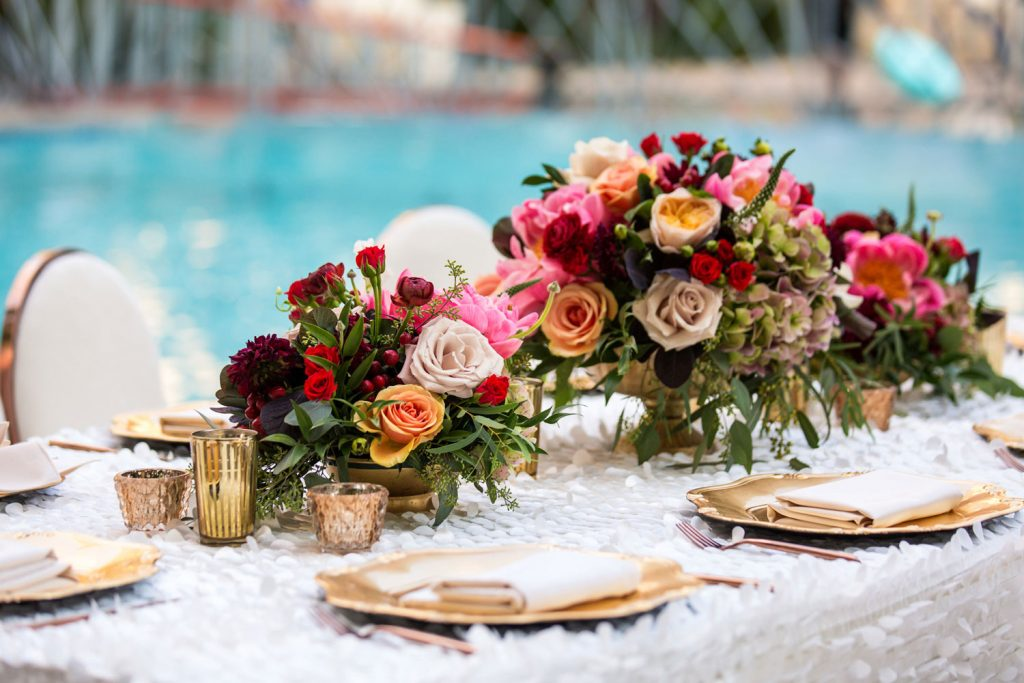 the-fresh-flower-bouquet-with-golden-cutlery-table-top