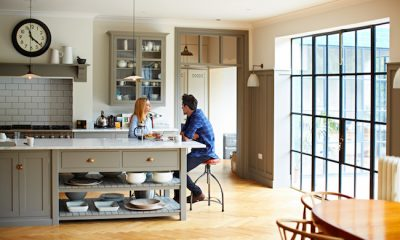 Shot of a young couple having breakfast in their kitchen