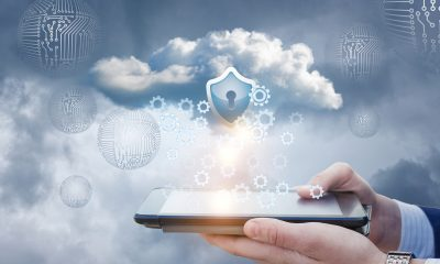 Businessman works with protected data cloud on the tablet. A concept design.