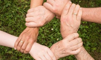 People joining hands together.