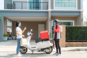 asian-woman-pick-up-delivery-food-bag-from-box-thumb-up-form-contactless-contact-free-from-delivery-rider-with-bicycle-front-house-social-distancing-infection-risk-coronavirus-concept_73503-1929