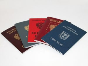 passports from different nations from immigrants moving to Canada