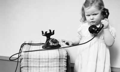 Child talking on the telephone --- Image by © H. Armstrong Roberts/CORBIS