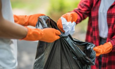 men-women-help-each-other-collect-garbage-min